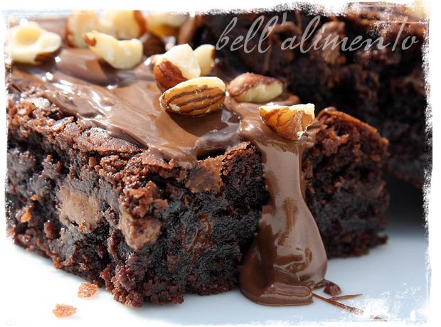 Nutella Caramel Hazelnut Brownies on white plate.