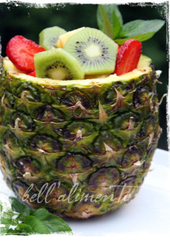 Pineapple filled with fresh fruit.