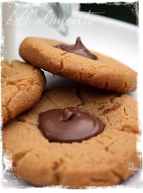 Three thumbprint cookies on white plate.