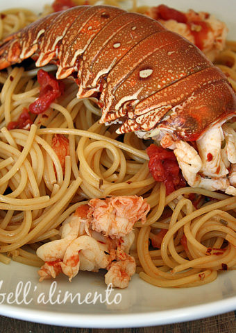 lobster pasta in white bowl.