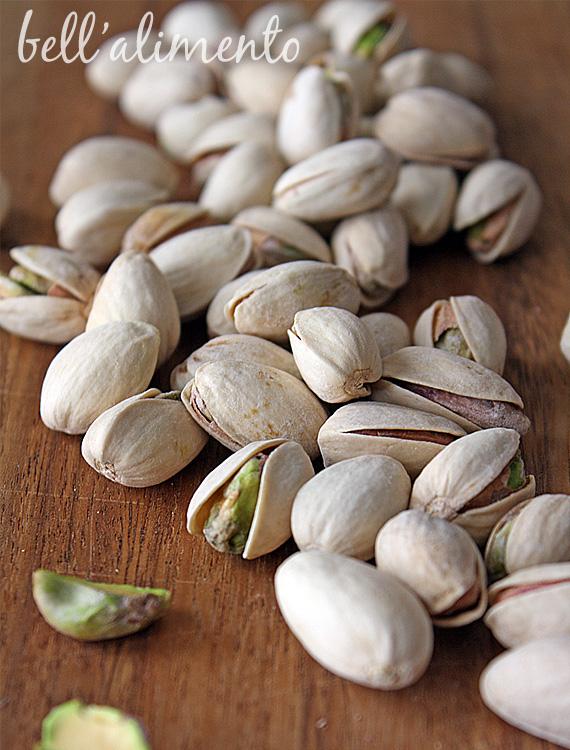 closeup photo of pistachios on cutting board.