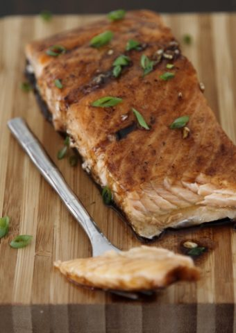 Maple Balsamic Glazed Salmon on cutting board with fork