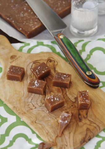 squares of nutella caramel on cutting board with knife