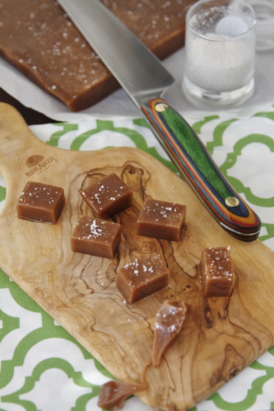 squares of nutella caramels on a cutting board with knife