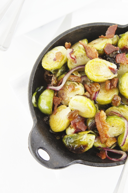 roasted brussels sprouts with bacon in cast iron pan.