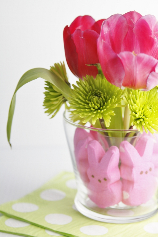 Hot pink tulips in vase with Peeps around base to create centerpiece.