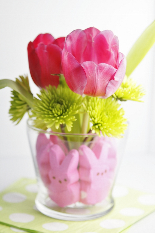 Tulips in a glass vase with Peeps around bottom to create a center piece.