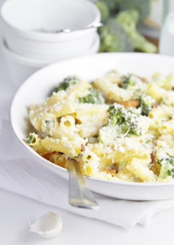 Cheesy Broccoli and Bacon Pasta Bake in white bowl.