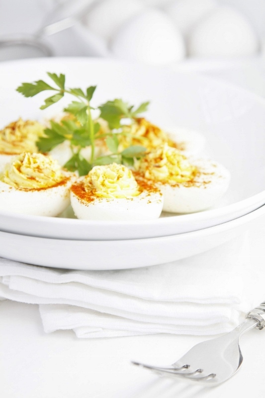 Classic Deviled Eggs on white plate garnished with parsley