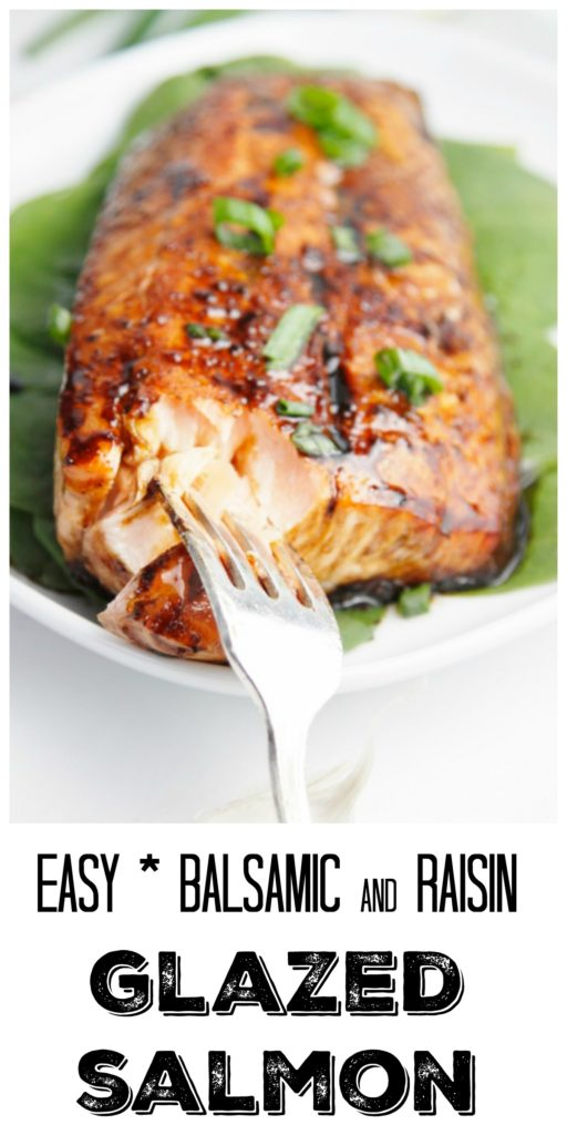 glazed salmon on bed of spinach on white plate with fork.