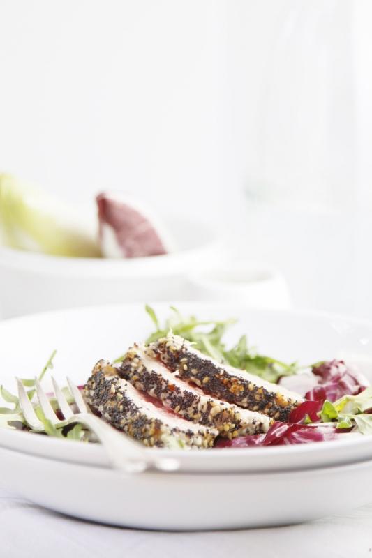 Sesame Seared Ahi Tuna Salad on white plate. Fork to left.