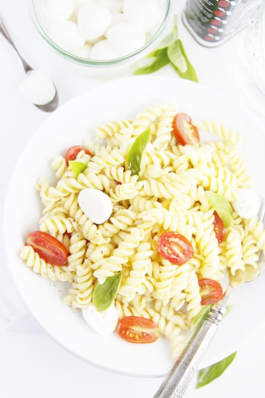 Spicy Caprese Pasta Salad in white bowl