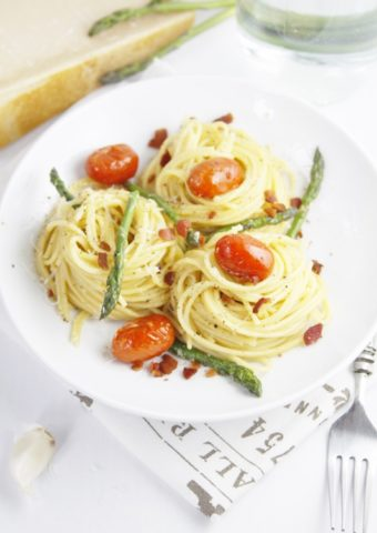 Asparagus and Tomato Carbonara in white bowl.