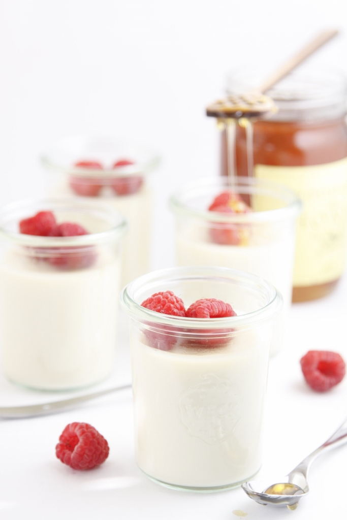 Chai Panna Cotta in small glass jars with raspberries