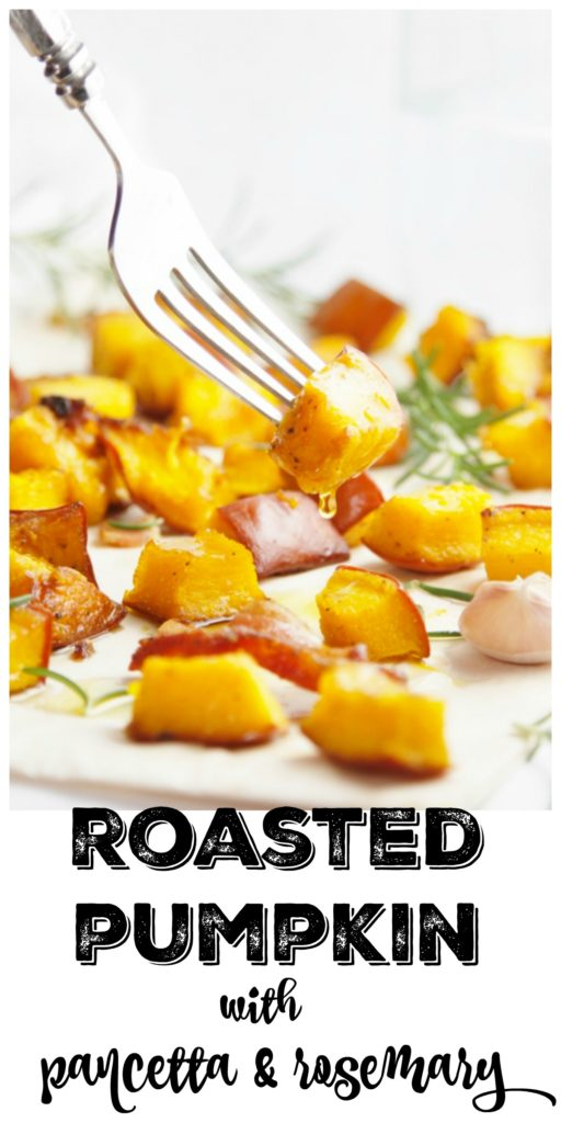 Roasted Pumpkin with Pancetta and Rosemary on a baking sheet with fork in one piece