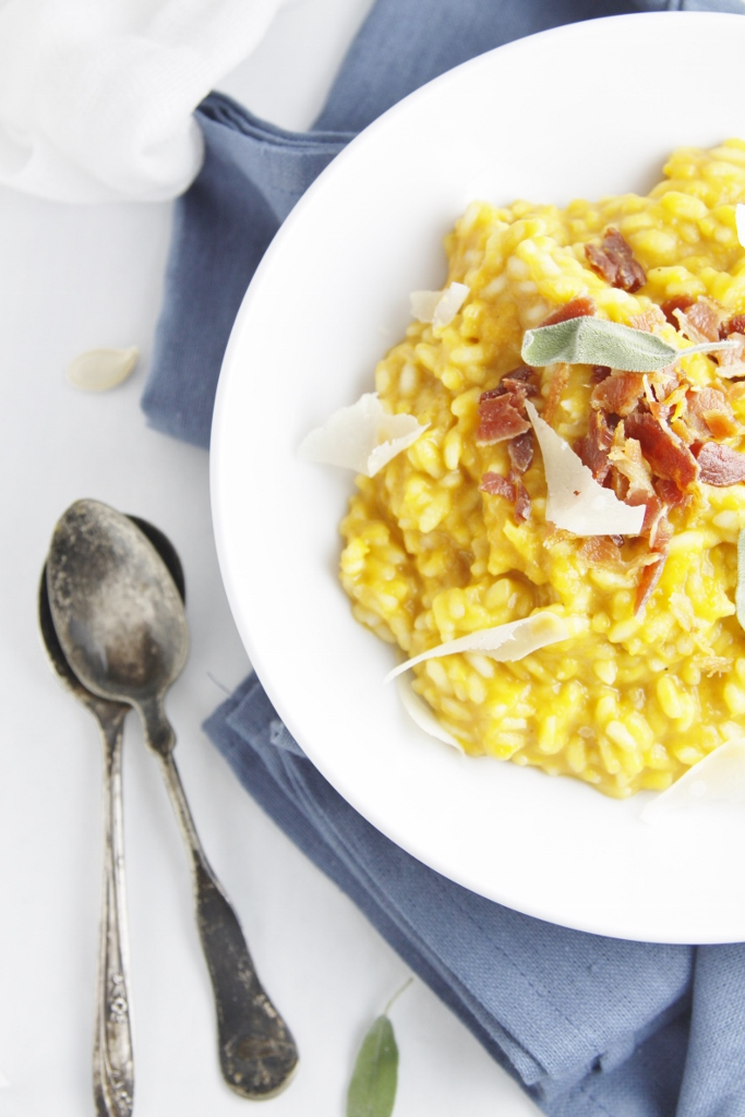 bowl of Roasted Pumpkin Risotto with Pancetta on blue napkin with spoons