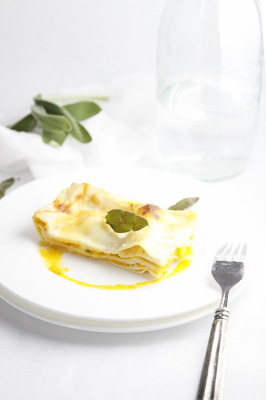 Roasted Butternut Squash Lasagna on whit plate with fork.
