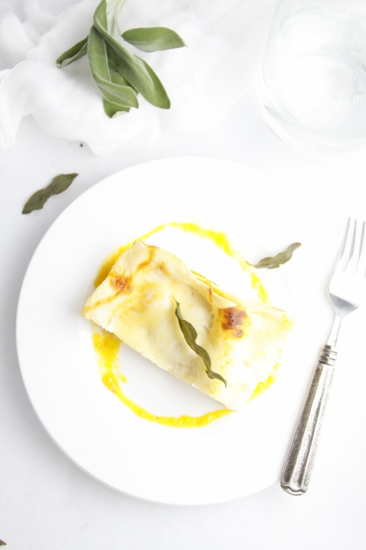 Roasted Butternut Squash Lasagna on white plate with fork.
