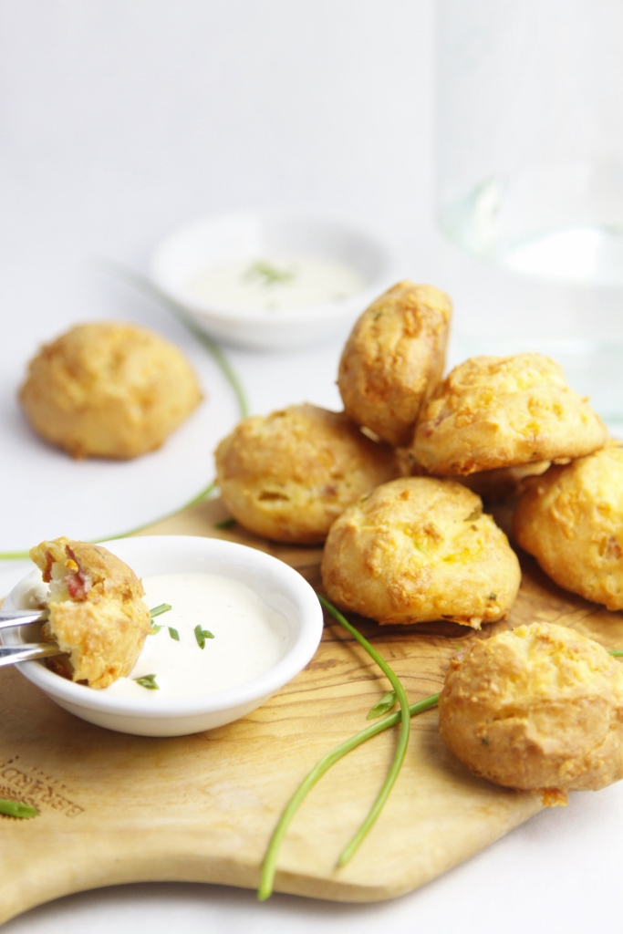 Theses are bites of cheesy bacon goodness and are easier to make than you may think. Ranch Bacon and Chive Gougeres #bacon #ranch #gougeres #cheesebiscuits #appetizer