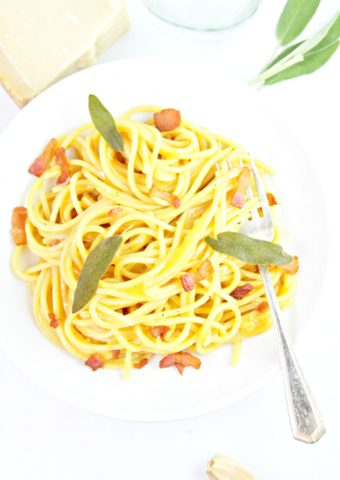 squash carbonara in white bowl with fork