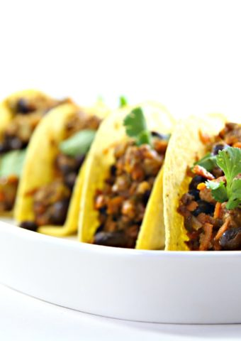 4 black bean turkey tacos standing in shallow white dish