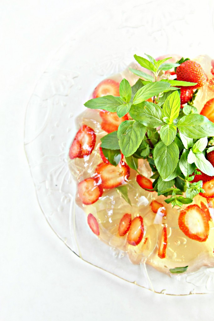 Champagne Gelatin Mold garnished with fresh mint and strawberries.