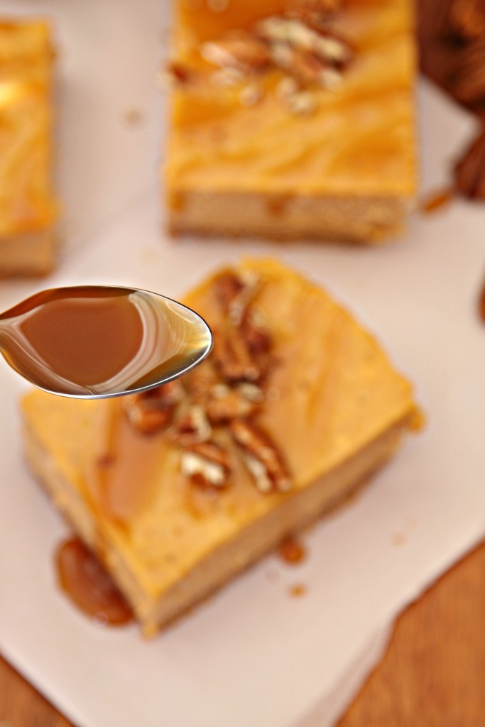 Pumpkin Cheesecake Bars with Whiskey Caramel Sauce