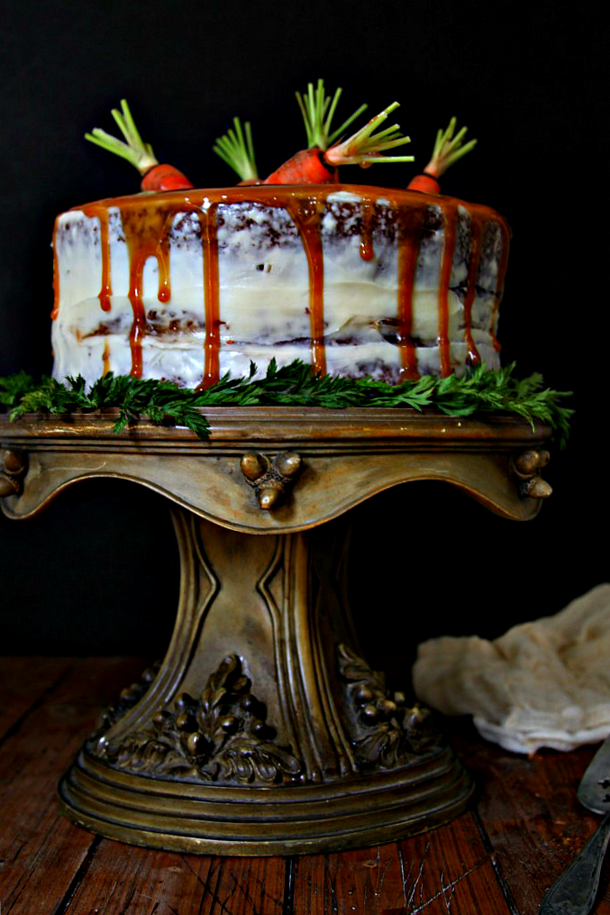 Old Fashioned Carrot Cake on cake stand. Serving piece to side.