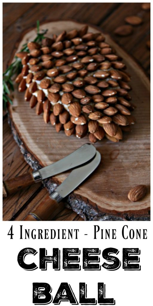pine cone shaped holiday cheese ball on wood with cheese spreaders