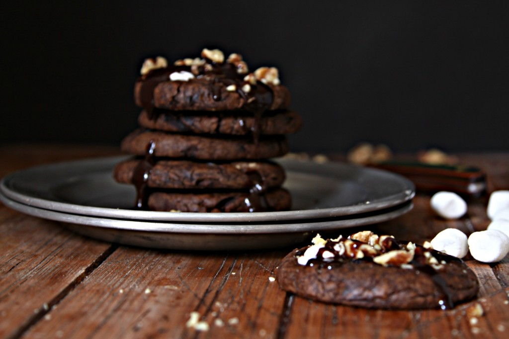 Stack of Rocky Road Cookies on metal plate. Cookie in front with marshmallows scattered to side.