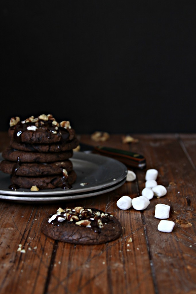 Stack of Rocky Road Cookies on a metal plate. Cookie in front with marshmallows scattered to side.