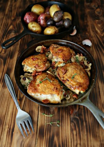 Pan Fried Chicken in cast iron skillet. Serving fork to side.