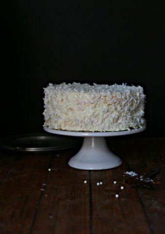 Coconut Cake on white cake plate