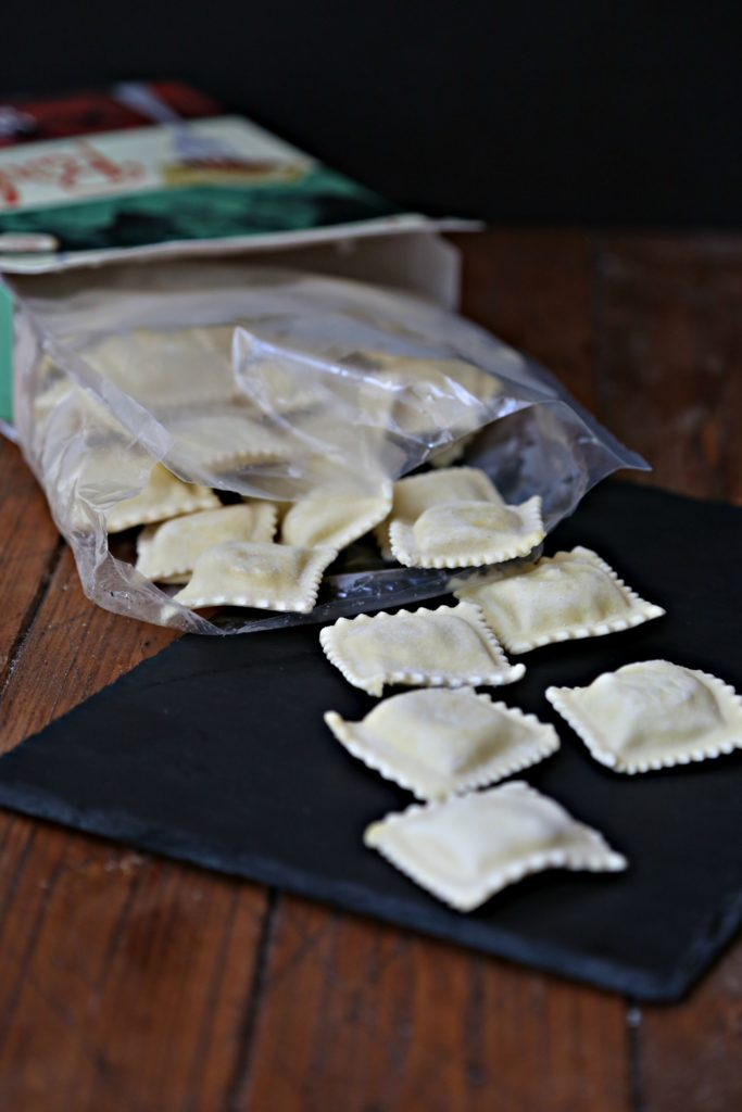 Box of Parla Lobster Ravioli on it's side with ravioli spilling out.