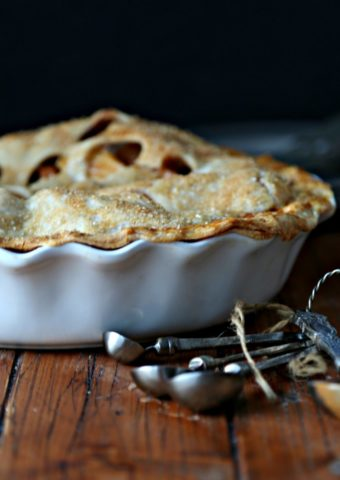 Momma's Apple Pie with measuring spoons to side
