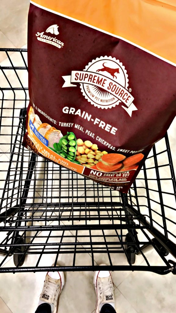bag of supreme source dog food in shopping cart