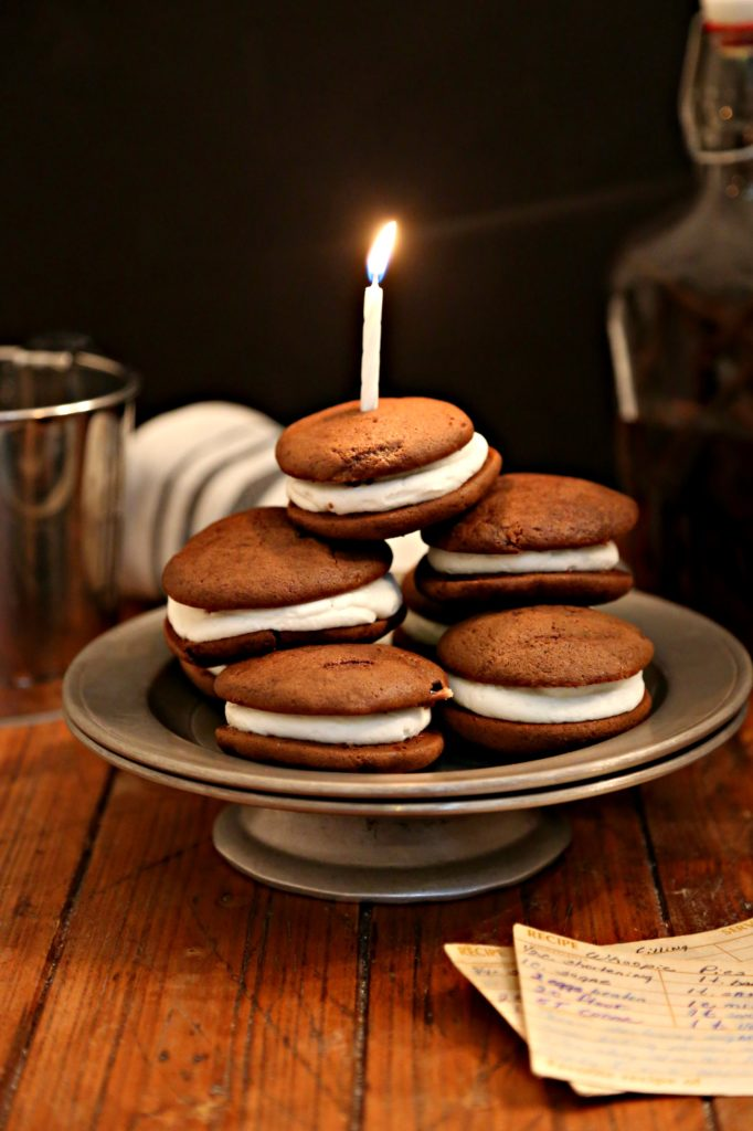 Mommas Old Fashioned Whoopies Pies On A Silver Cake Plate Topped With Birthday Candle Bottle