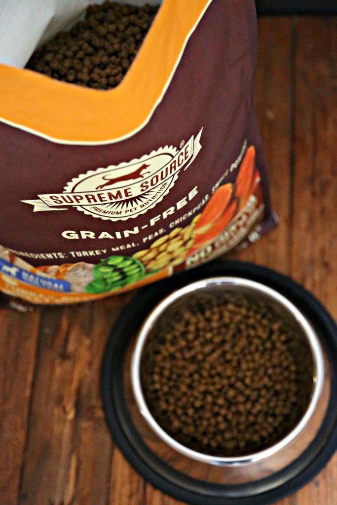 bag of pet food bowl of pet food