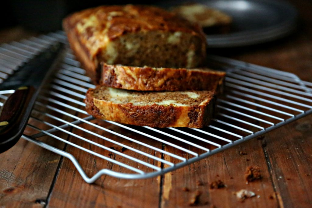 Banana Bread with Mascarpone Cheese Swirl on bakin rack sliced