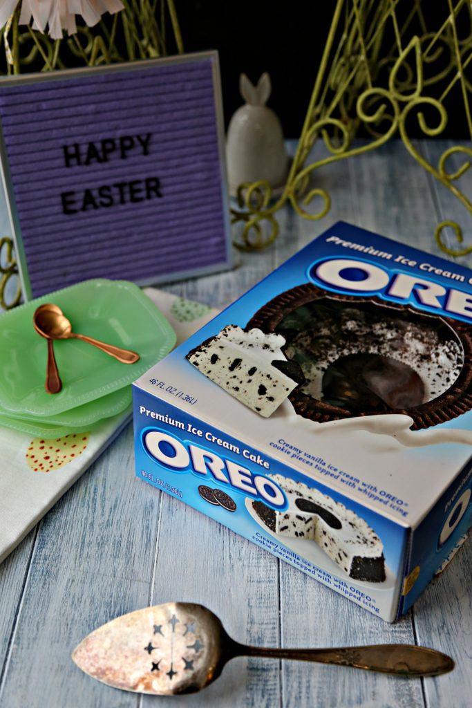 oreo ice cream cake in box with happy easter sign and green plates and gold spoons