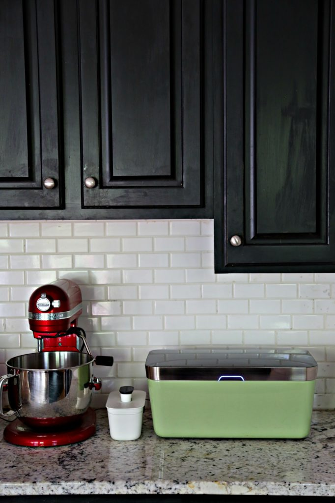 vacuvita on kitchen counter with black cabinets