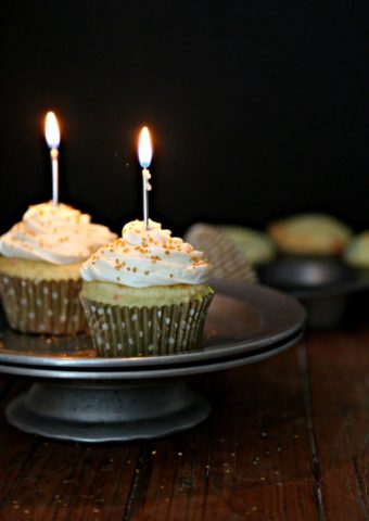 Funfetti Cupcakes with candles on cake stand