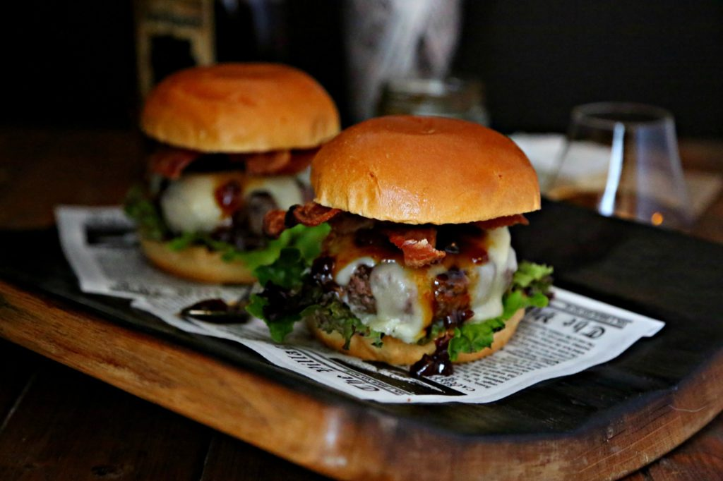 Bacon Brie Brioche Burgers on a cutting board