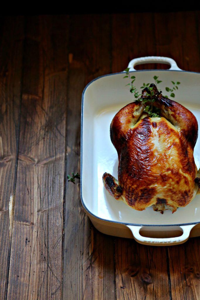 Buttermilk Brined Roast Chicken in a white roasting pan