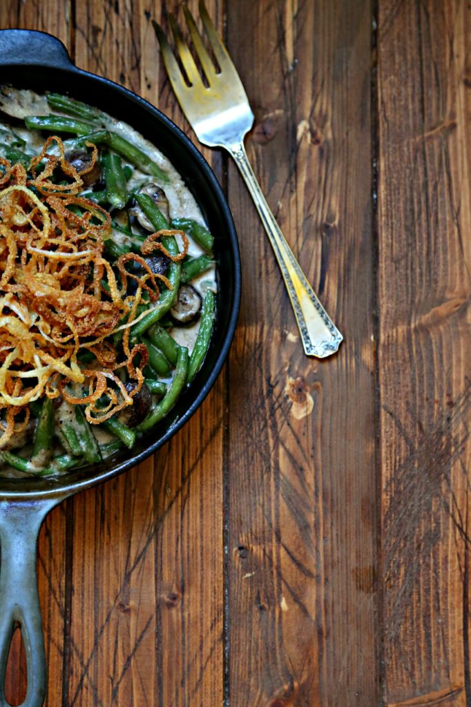 Fresh Green Bean Casserole with Crispy Onion in skillet with serving fork