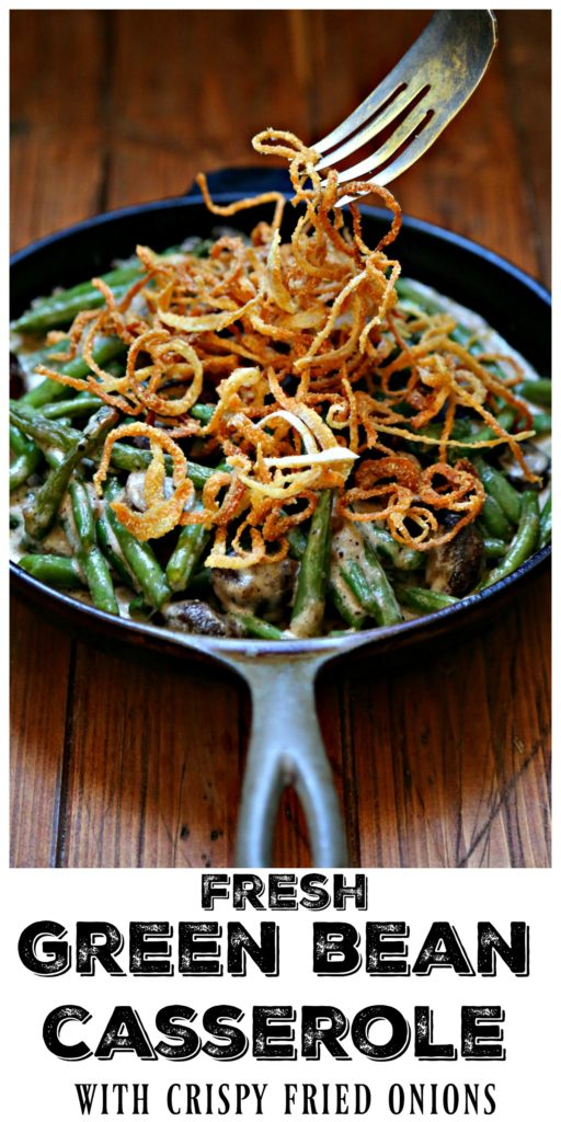 Fresh Green Bean Casserole with Crispy onions in skillet with serving fork pulling onions up