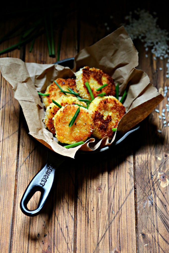 Saffron Risotto Cakes in skillet topped with chives