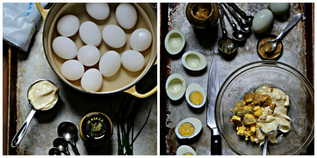 Pot of boile eggs. Jar of Maille mustard, fresh chives on baking sheet. Deviled Eggs on platter with jar of mustard and egg shells behind.