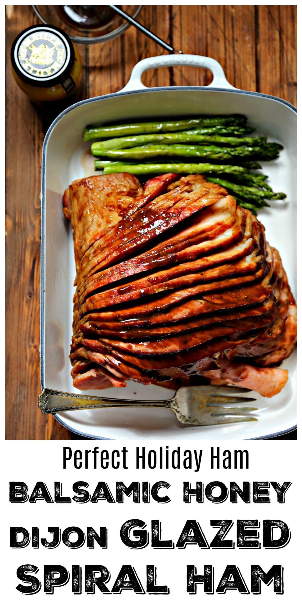 Balsamic Honey Dijon Glazed Spiral Ham in white roasting pan with asparagus The Best Easter Ham Recipe