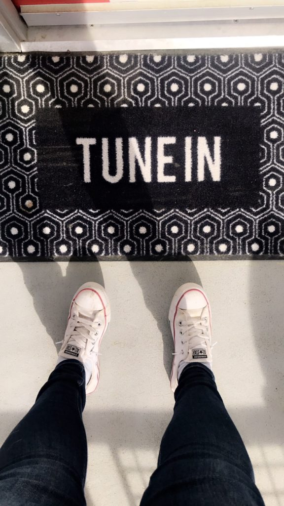 door mat that says tune in.